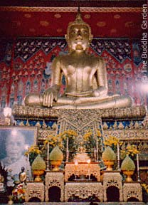 the main Buddha statue in the Viharn of a temple in Thonburi, Thailand