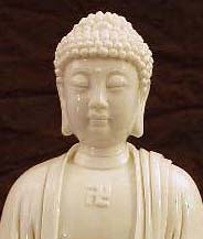 A Swastika Image On A Statue Of The Buddha